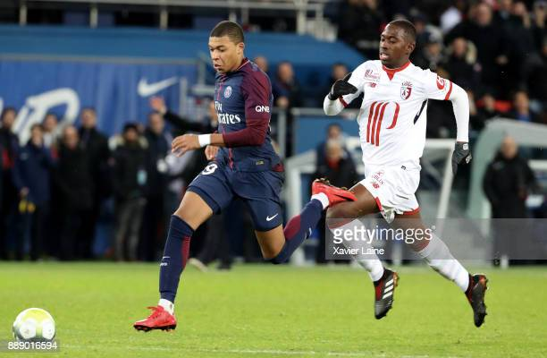 Kylian Mbappe of Paris SaintGermain in action with Boubakary Soumare of Lille OSC during the Ligue 1 match between Paris Saint Germain and Lille OSC...