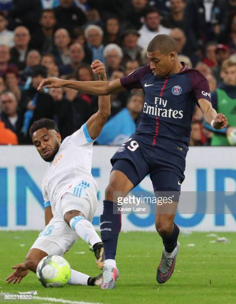 Kylian Mbappe of Paris SaintGermain in action with jordan Amavi of Olympique Marseille during the Ligue 1cmatch between Olympique Marseille and Paris...