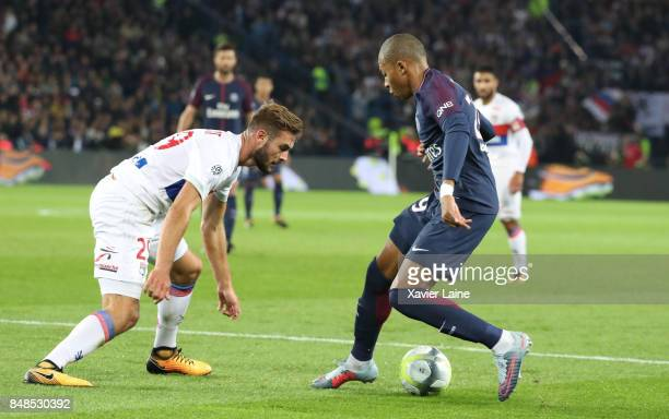 Kylian Mbappe of Paris SaintGermain in action with Lucas Tousart of Olympique Lyonnais during the French Ligue 1 match between Paris Saint Germain...