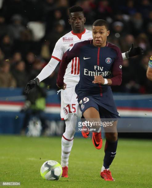 Kylian Mbappe of Paris SaintGermain in action with Miguel IE of Lille OSC during the Ligue 1 match between Paris Saint Germain and Lille OSC at Parc...
