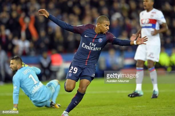 Kylian Mbappe of Paris SaintGermain reacts after scoring during the Ligue 1 match between Paris Saint Germain and Olympique Lyonnais at Parc des...