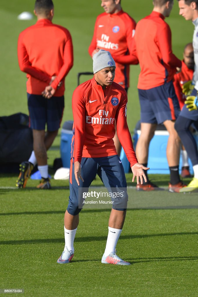 Kylian Mbappe of Paris Saint-Germain reacts as he arrives for a Paris Saint-Germain training session at Centre Ooredoo on October 12, 2017 in Paris, France.