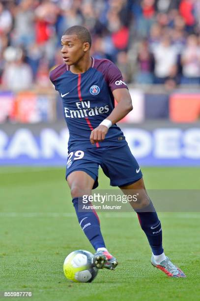 Kylian Mbappe of Paris SaintGermain runs with the ball during the Ligue 1 match between Paris Saint Germain and FC Girondins de Bordeaux at Parc des...