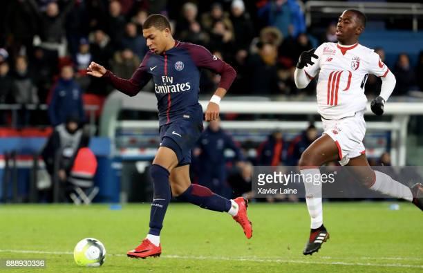 Kylian Mbappe of Paris SaintGermain scores a goal during the Ligue 1 match between Paris Saint Germain and Lille OSC at Parc des Princes on December...