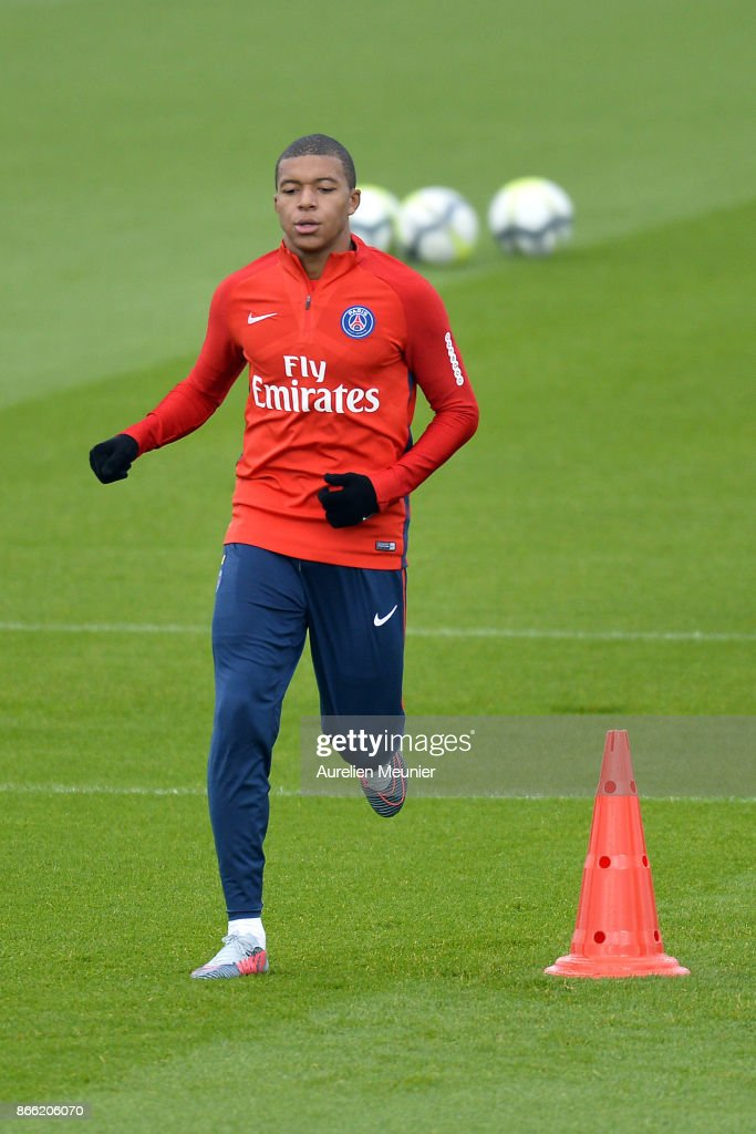 Kylian Mbappe of Paris Saint-Germain warms up during a Paris Saint-Germain practice session at Centre Ooredoo on October 25, 2017 in Paris, France.