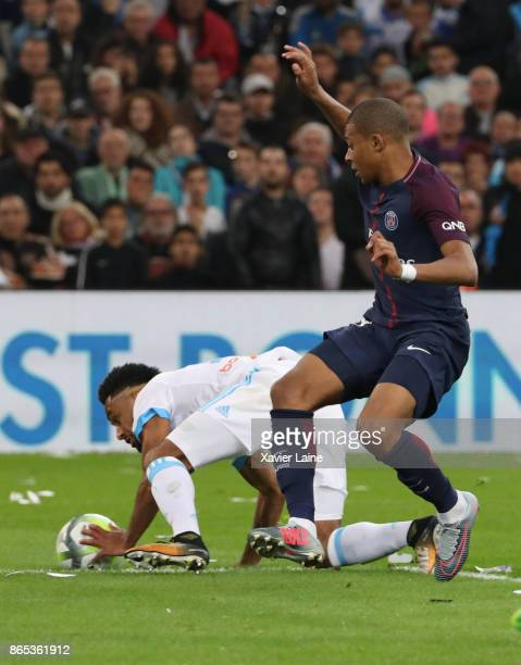 Kylian Mbappe of Paris SaintGermain watch Jordan Amavi of Olympique Marseille touches the ball with his hand in the penalty area and is not...