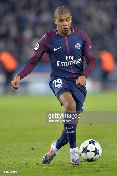 Kylian Mbappe of ParisGermain runs with the ball during the UEFA Champions League group B match between Paris SaintGermain and RSC Anderlecht at Parc...