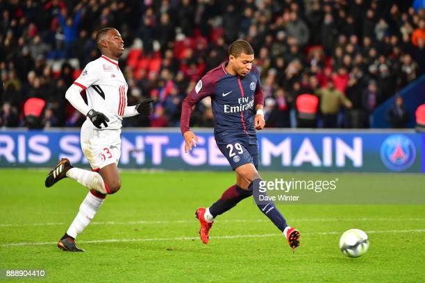 Kylian Mbappe of PSG breaks away to score a last second goal during the Ligue 1 match between Paris Saint Germain and Lille OSC at Parc des Princes...
