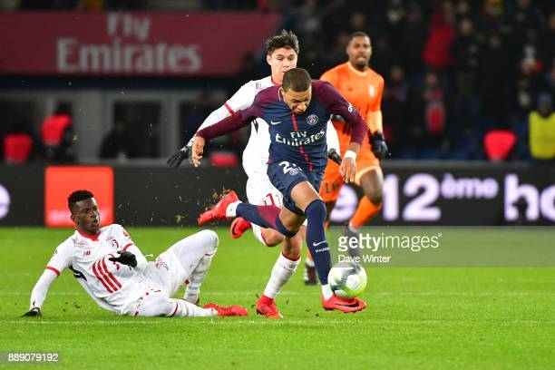 Kylian Mbappe of PSG breaks away to score a last second goal into the empty Lille net during the Ligue 1 match between Paris Saint Germain and Lille...