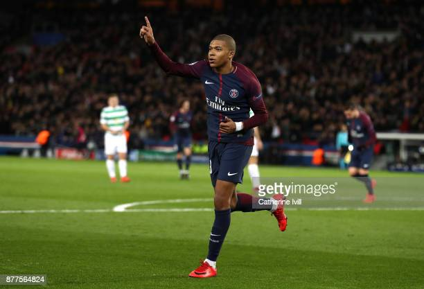 Kylian Mbappe of PSG celebrates after scoring his sides fourth goal during the UEFA Champions League group B match between Paris SaintGermain and...