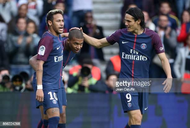 Kylian Mbappe of PSG celebrates his goal between Neymar Jr and Edinson Cavani during the French Ligue 1 match between Paris SaintGermain and FC...