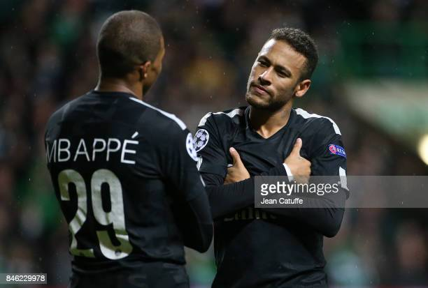 Kylian Mbappe of PSG celebrates his goal with Neymar Jr during the UEFA Champions League match between Celtic Glasgow and Paris Saint Germain at...