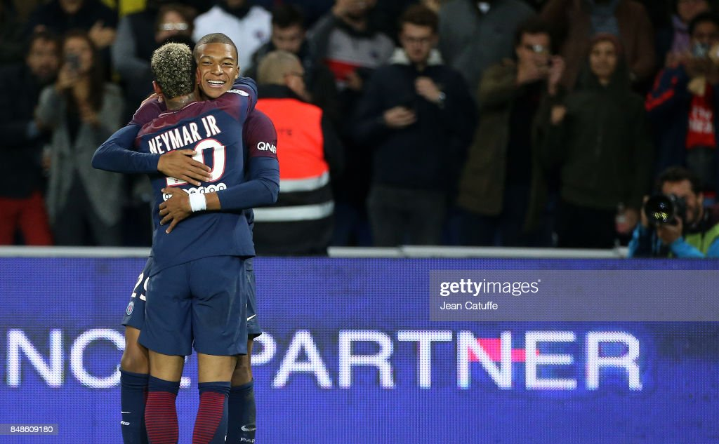 Kylian Mbappe of PSG celebrates his goal with Neymar Jr during the French Ligue 1 match between Paris Saint Germain (PSG) and Olympique Lyonnais (OL) at Parc des Princes on September 17, 2017 in Paris, .