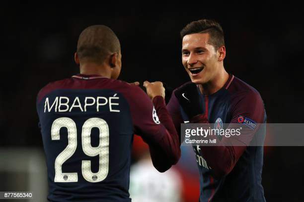 Kylian Mbappe of PSG celebrates with Julian Draxler of PSG after he scores his sides fourth goal during the UEFA Champions League group B match...