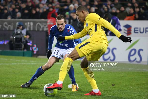 Kylian Mbappe of PSG Dimitri Lienard of Strasbourg during the French Ligue 1 match between RC Strasbourg Alsace and Paris Saint Germain at Stade de...