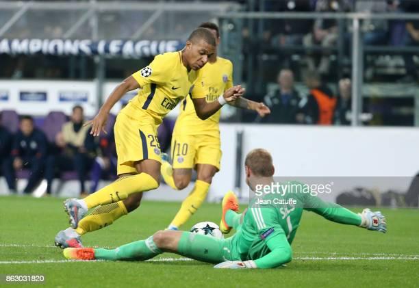 Kylian Mbappe of PSG goalkeeper of Anderlecht Matz Sels during the UEFA Champions League match between RSC Anderlecht and Paris Saint Germain at...