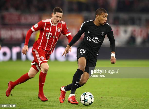 Kylian Mbappe of PSG is put under pressure by Sebastian Rudy of Bayern Muenchen during the UEFA Champions League group B match between Bayern...