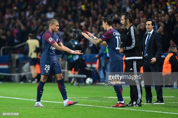 Kylian Mbappe of PSG is replaced by Angel Di Maria of PSG during the Uefa Champions League match between Paris Saint Germain and FC Bayern Munich on...