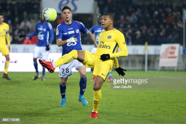 Kylian Mbappe of PSG Jonas Martin of Strasbourg during the French Ligue 1 match between RC Strasbourg Alsace and Paris Saint Germain at Stade de la...