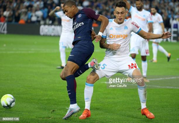 Kylian Mbappe of PSG Lucas Ocampos of OM during the French Ligue 1 match between Olympique de Marseille and Paris Saint Germain at Stade Velodrome on...