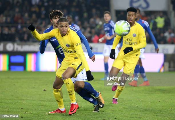 Kylian Mbappe of PSG Martin Terrier of Strasbourg during the French Ligue 1 match between RC Strasbourg Alsace and Paris Saint Germain at Stade de la...