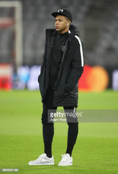Kylian Mbappe of PSG walks on the pitch on the eve of their UEFA Champions League match against Bayern Muenchen at Allianz Arena on December 4 2017...