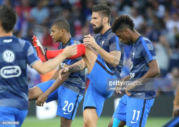 Kylian Mbappe Olivier Giroud Kingsley Coman of France warm up before the FIFA 2018 World Cup Qualifier between France and Luxembourg at the Stadium...