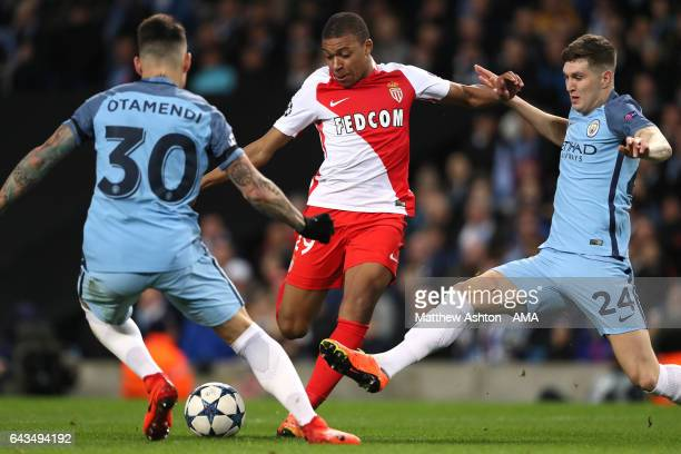 Kylian MbappeLottin of Monaco competes with John Stones of Manchester City during the UEFA Champions League Round of 16 first leg match between...