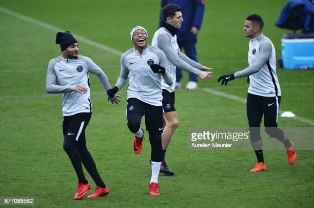 Kylian R Layvin Kurzawa and Mbappe warm up before a Paris SaintGermain training session at Centre Ooredoo on November 21 2017 in Paris France