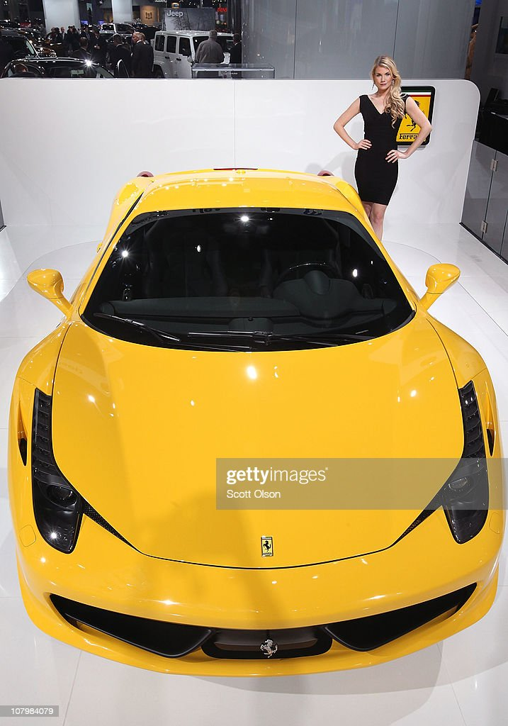 Kylie Brudenell poses with a Ferrari 458 Italia during the press preview of the North American International Auto Show at the Cobo Center on January 11, 2011 in Detroit, Michigan. The show is currently opened only for media previews and opens to the general public January 15-23.