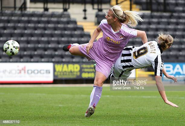 Kylie Davies of Reading FC Women collides with Ellen White of Notts Ladies County FC during the FA WSL Continental Tyres Cup Quarter Final between...