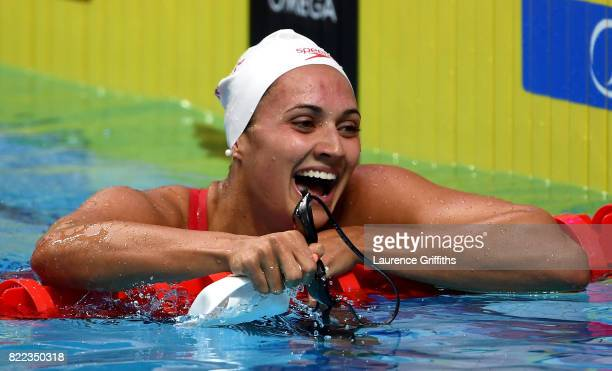 Kylie Jacqueline Masse of Canada celebrates after winning the gold medal in a world record time of 5810 during the Women's 100m Backstroke final on...