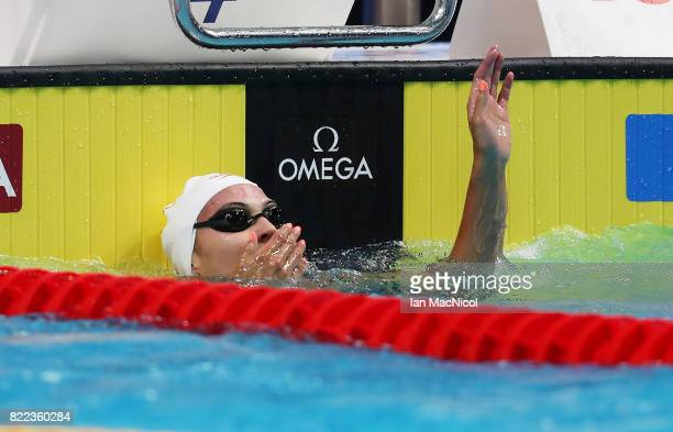 Kylie Jacqueline Masse of Canada reacts as she breaks the world record during the Woens 100m Backstroke semi final during day twelve of the FINA...
