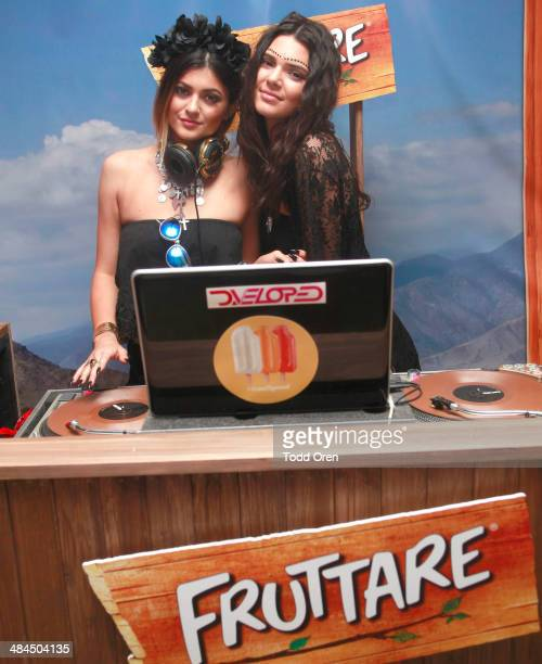 Kylie Jenner and Kendall Jenner spin for festivalgoers at the Fruttare Hangout at Coachella on April 12 2014 in Indio California