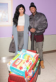 Kylie Jenner and recording artist Tyga arrive bearing gifts at the LA Gear Presents Teen Impact Holiday Party Hosted By Tyga At Childrens Hospital LA...