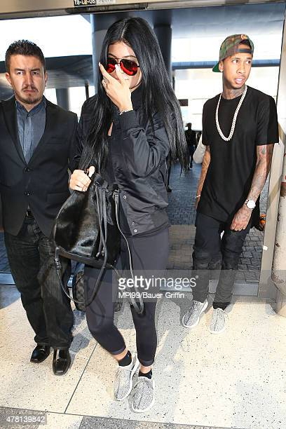 Kylie Jenner and Tyga seen at LAX leaving for a flight to France on June 22 2015 in Los Angeles California