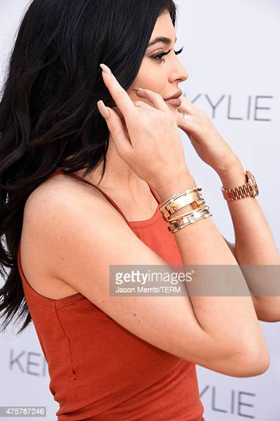 Kylie Jenner bracelet detail attends a launch party for the Kendall Kylie fashion line at TopShop on June 3 2015 in Los Angeles California