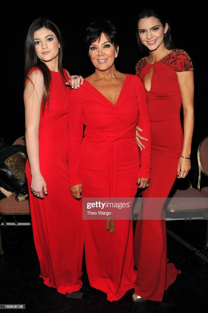 Kylie, Kris and Kendall Jenner pose backstage at the Heart Truth 2013 Fashion Show at Hammerstein Ballroom on February 6, 2013 in New York City.