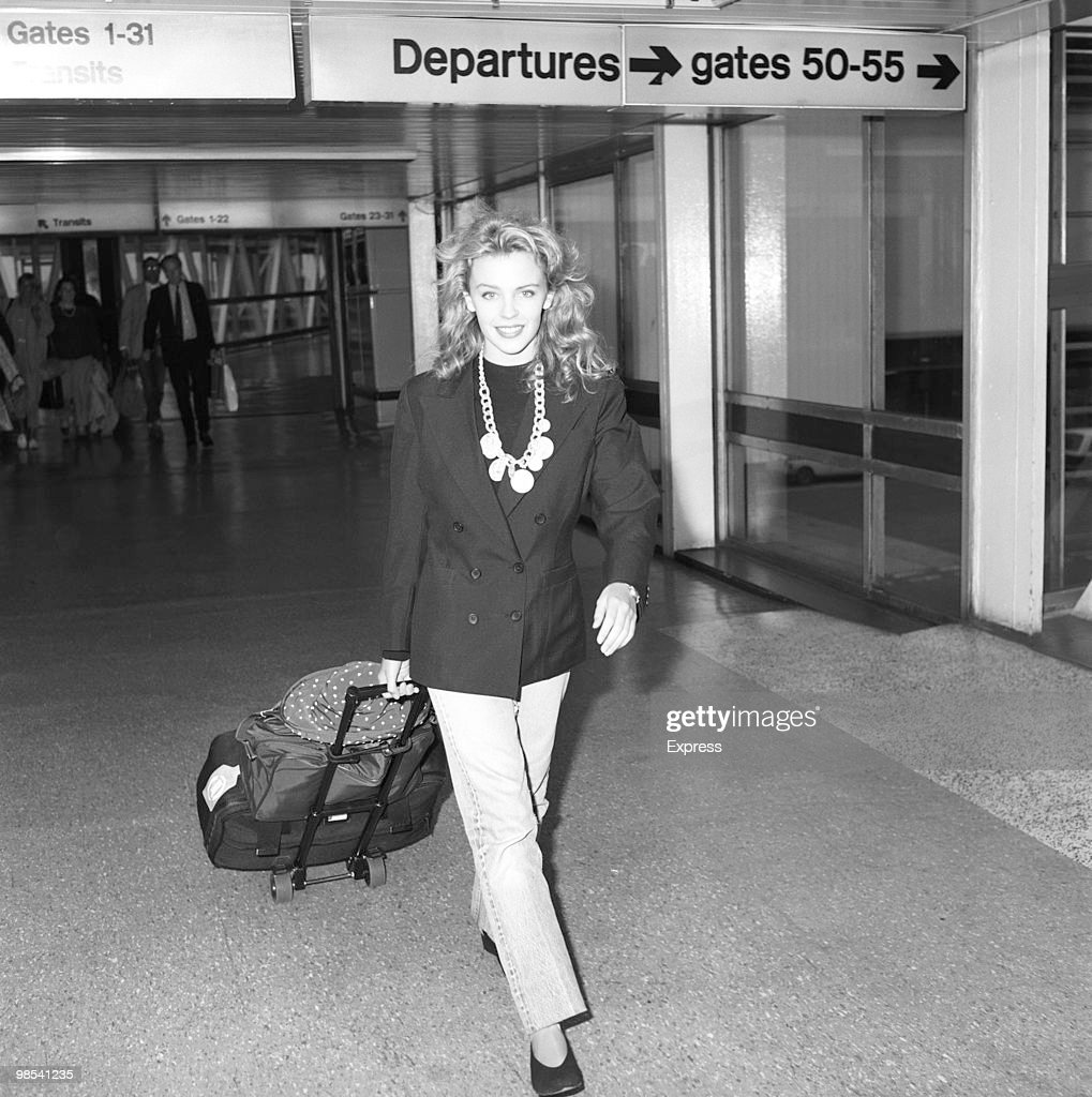 <a gi-track='captionPersonalityLinkClicked' href=/galleries/search?phrase=Kylie+Minogue&family=editorial&specificpeople=201671 ng-click='$event.stopPropagation()'>Kylie Minogue</a>, actress and singer, pictured at Heathrow Airport as she arrived, along with the cast of Australian soap opera 'Neighbours', to appear at the Royal Variety Performance. London, 21 November 1988.