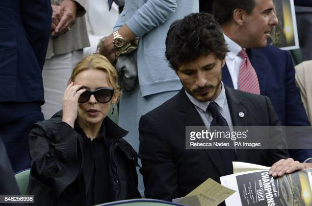 Kylie Minogue and Andres Velencoso arrive in the Royal Box during day eleven of the 2012 Wimbledon Championships at the All England Lawn Tennis Club...