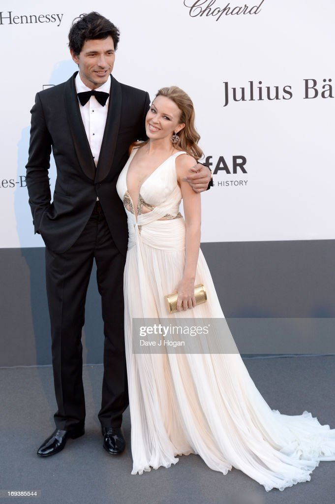 <a gi-track='captionPersonalityLinkClicked' href=/galleries/search?phrase=Kylie+Minogue&family=editorial&specificpeople=201671 ng-click='$event.stopPropagation()'>Kylie Minogue</a> and Andres Velencoso attends amfAR's 20th Annual Cinema Against AIDS during The 66th Annual Cannes Film Festival at Hotel du Cap-Eden-Roc on May 23, 2013 in Cap d'Antibes, France.