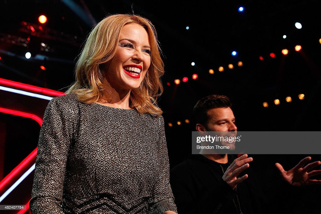 Kylie Minogue and Johnny Rollins share a joke during a media call with the final five contestants and their coaches from The Voice at Fox Studios on July 20, 2014 in Sydney, Australia.