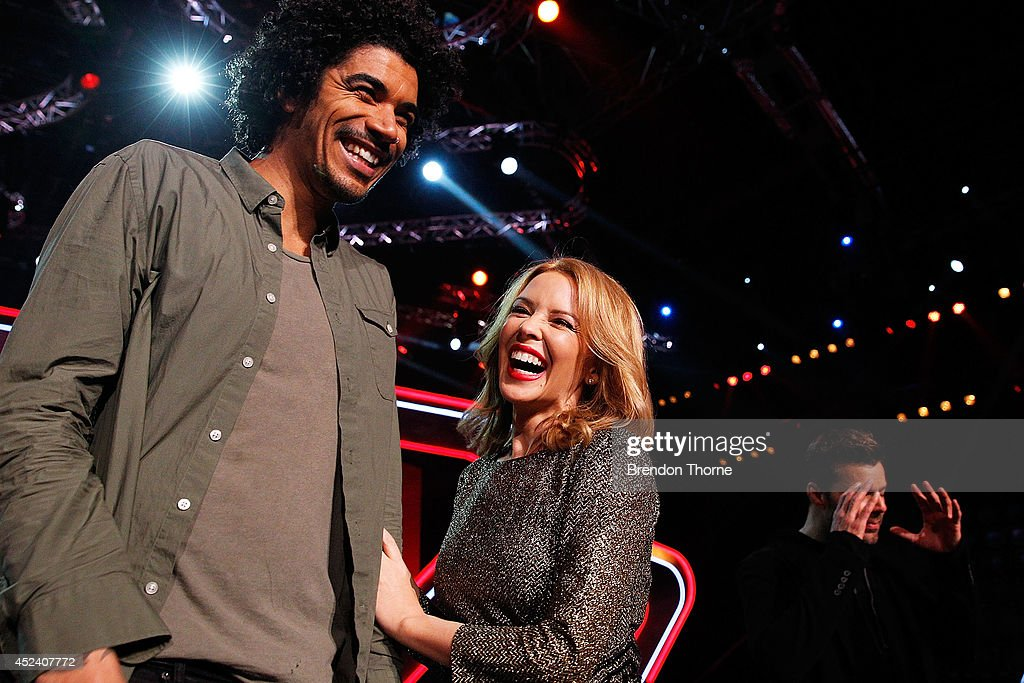 <a gi-track='captionPersonalityLinkClicked' href=/galleries/search?phrase=Kylie+Minogue&family=editorial&specificpeople=201671 ng-click='$event.stopPropagation()'>Kylie Minogue</a> and Johnny Rollins share a joke during a media call with the final five contestants and their coaches from The Voice at Fox Studios on July 20, 2014 in Sydney, Australia.