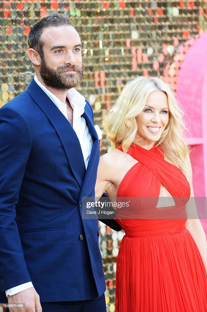 Kylie Minogue (R) and Joshua Sasse attend the World Premiere of 'Absolutely Fabulous: The Movie' at Odeon Leicester Square on June 29, 2016 in London, England.