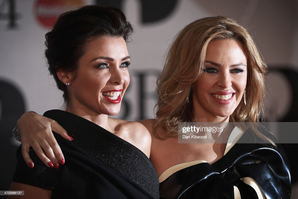 Kylie Minogue (R) and sister Danii Minogue attend the BRIT Awards 2014 at 02 Arena on February 19, 2014 in London, England.
