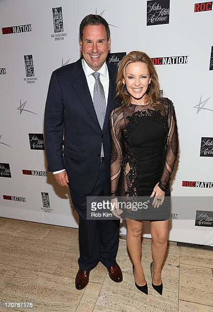 Kylie Minogue and Stephen Sadove Chairman CEO Saks Fifth Avenue attend the release of 'KYLIE FASHION' Exclusive Book Signing at New York's Legendary...