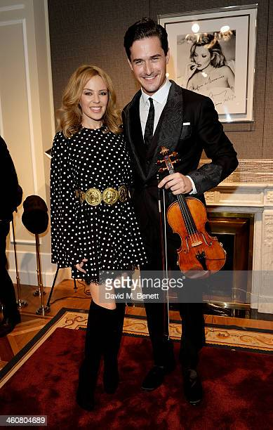 Kylie Minogue and violinist Charlie Siem attend the Dolce Gabbana London Collections Men event at the Dolce Gabbana New Bond Street store on January...