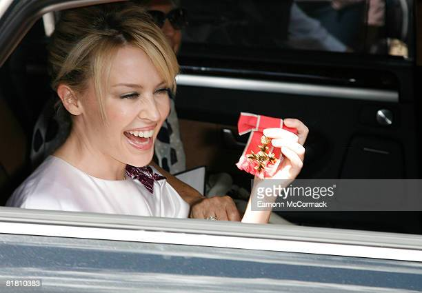 Kylie Minogue departs Buckingham Palace after receiving OBE at Buckingham Palace on July 3 2008 in London
