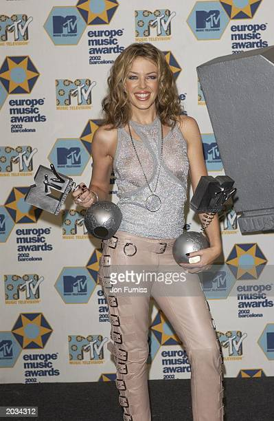 Kylie Minogue holding two gongs at the MTV European Music Awards held on November 14 2002 at Palau Sant Jordi pavillion in Barcelona Spain Kylie is...