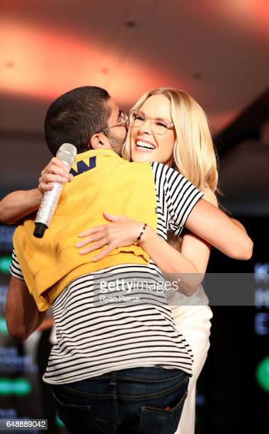 Kylie Minogue hugs a fan on stage at the launch of her eyewear collection for Specsavers at the Establishment Ballroom on March 7 2017 in Sydney...
